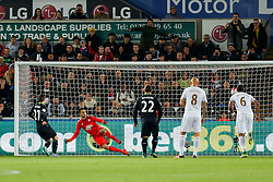 Lukasz Fabianski of Swansea City dives the wrong way as Bojan Krkic of Stoke City scores a goal from the penalty spot to make it 0-1 - Mandatory byline: Rogan Thomson/JMP - 07966 386802 - 19/10/2015 - FOOTBALL - Liberty Stadium - Swansea, Wales - Swansea City v Stoke City - Barclays Premier League.