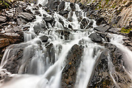 Waterfall at Crow Pass in Chugach National Forest in Southcentral Alaska. Summer. Afternoon.