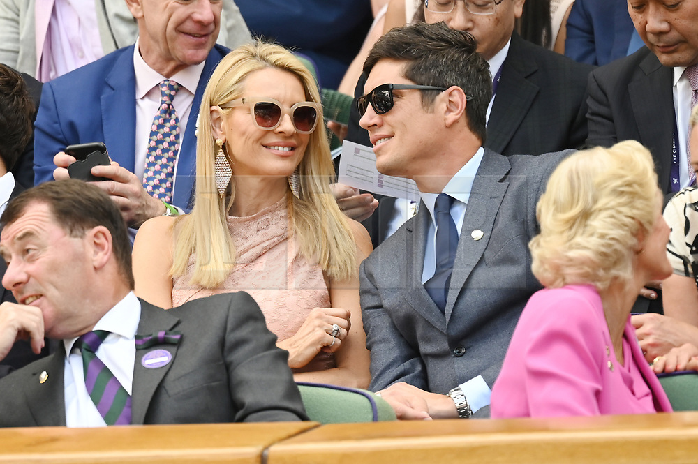 © Licensed to London News Pictures. 03/07/2019. London, UK.  Tess Daly and Vernon Kay watch center court tennis from the Royal Box on Day 3 of the Wimbledon Tennis Championships 2019, held at the All England Lawn Tennis and Croquet Club. Photo credit: Ray Tang/LNP