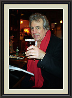 Terry Jones having a Pint in Sohos Coach & Horses<br /> Museum-quality Archival Large signed Framed A3 Photograph limited edition  £500