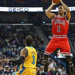 February 12, 2011; New Orleans, LA, USA; Chicago Bulls point guard Derrick Rose (1) shoots over New Orleans Hornets point guard Chris Paul (3) during the first quarter at the New Orleans Arena.   Mandatory Credit: Derick E. Hingle