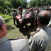 Lafayette County Sheriff's carry the casket of of their former Sheriff Buddy East to his gravesite Friday afternoon.