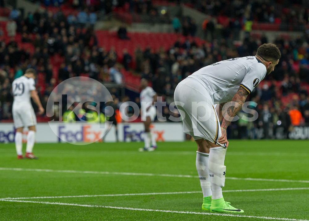 Kyle Walker of Tottenham Hotspur and the Tottenham players look dejected after the UEFA Europa League  Round of 32 Game 2 match between Tottenham Hotspur and Gent at Wembley Stadium, London, England on 23 February 2017. Photo by Vince  Mignott.