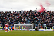 Charlton Athletic fans let off a flare after their equaliser during the EFL Sky Bet League 1 match between Gillingham and Charlton Athletic at the MEMS Priestfield Stadium, Gillingham, England on 22 October 2016. Photo by Andy Walter.