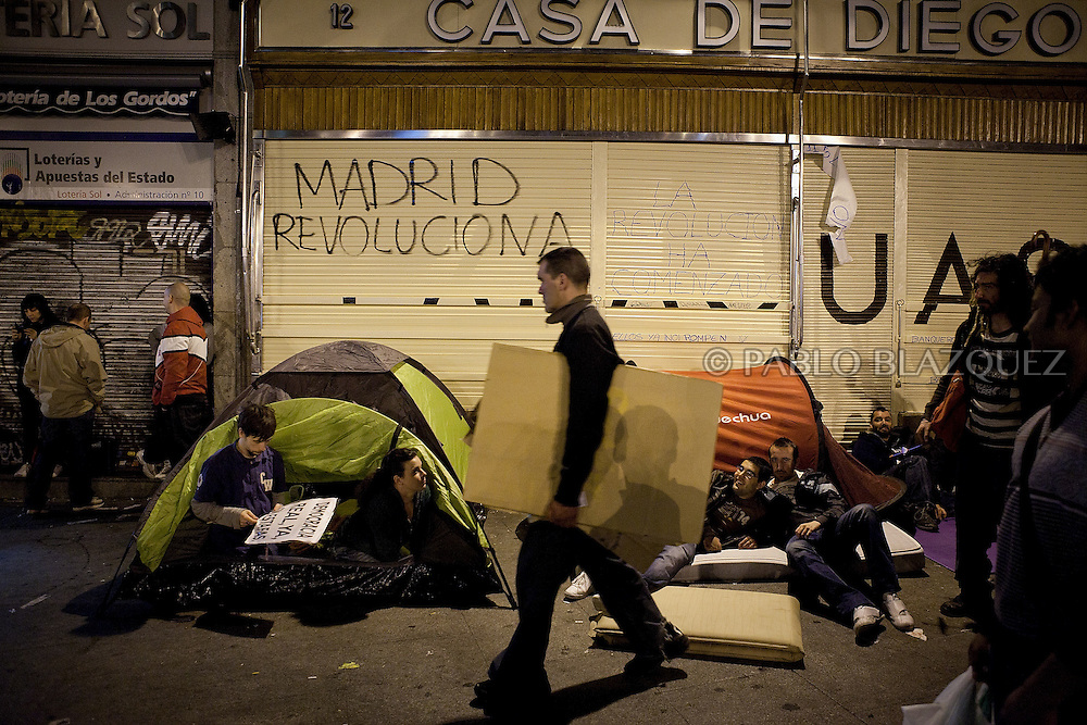 Demonstrators get ready to sleep at Puerta del Sol Square Camp on May 19, 2011 in Madrid, during protests against Spain's economic crisis and its sky-high jobless rate.Protests over the economic crisis began in Madrid on May 15 and fanned out to city squares nationwide as word spread by Twitter and Facebook among demonstrators known variously as 'the indignant', 'M-15', 'Spanish Revolution' and 'Real Democracy Now'.