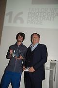 JOSH REDMAN RECEIVING THE KOBAL PRIZE FROM MICHAEL HOPPENPrivate view of the Taylor Wessing Portrait prize, National Portrait Gallery, London.  15 November 2016