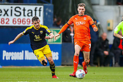 Luton Town defender Jack Stacey (7) goes past Oxford United midfielder Jamie Hanson (6) during the EFL Sky Bet League 1 match between Luton Town and Oxford United at Kenilworth Road, Luton, England on 4 May 2019.