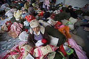 Liu Chunnan, 22, with her 10 day old baby in a camp for people whose homes were destroyed in the Sichuan earthquake.