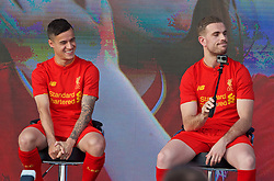 LIVERPOOL, ENGLAND - Monday, May 9, 2016: Liverpool's Philippe Coutinho Correia and captain Jordan Henderson with a GoPro and selfie stick at the launch of the New Balance 2016/17 Liverpool FC kit at a live event in front of supporters at the Royal Liver Building on Liverpool's historic World Heritage waterfront. (Pic by David Rawcliffe/Propaganda)