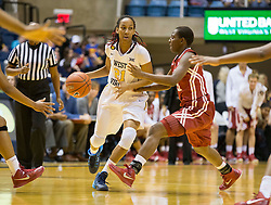 West Virginia Mountaineers guard Jessica Morton (21) drives through defenders against the Oklahoma Sooners during the second half at the WVU Coliseum.