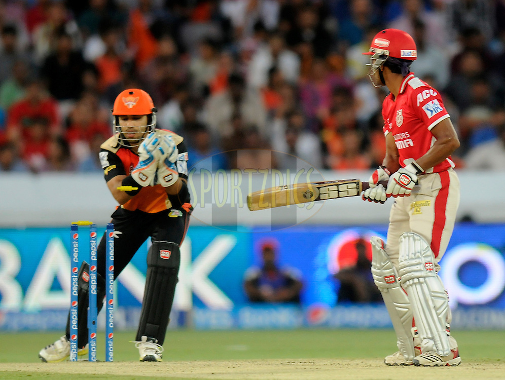 Wriddhiman Saha of the Kings X1 Punjab looks on as Naman Ohja of the Sunrisers Hyderabad takes the bails off to get his wicket during match 39 of the Pepsi Indian Premier League Season 2014 between the Sunrisers Hyderabad and the Kings XI Punjab held at the Rajiv Gandhi Cricket Stadium, Hyderabad, India on the 14th May  2014<br /> <br /> Photo by Pal Pillai / IPL / SPORTZPICS<br /> <br /> <br /> <br /> Image use subject to terms and conditions which can be found here:  http://sportzpics.photoshelter.com/gallery/Pepsi-IPL-Image-terms-and-conditions/G00004VW1IVJ.gB0/C0000TScjhBM6ikg