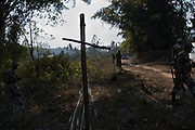 The Central Reserve Police Force patrol the jungle paths in an effort to allow safe passage through the jungle. Their presence however will be short lived and the villagers will be once again left to fend for themselves. In a meeting on February 8th, 2014 the The Karbi Anlong Autonomous Council promised to take a larger role in facilitating talks between the Karbi and Rengma-Naga tribes however the progress has been very slow. Image © Jonah Markowitz/Falcon Photo Agency