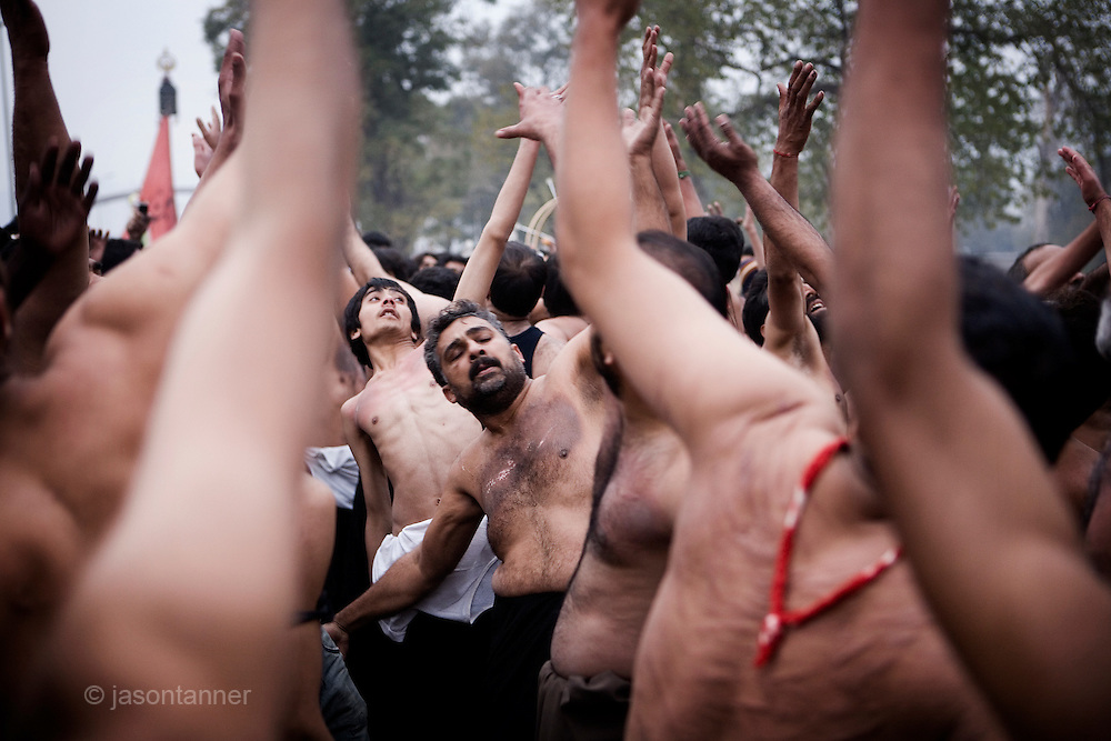 A Shiite religious procession on the ninth day of the holy Islamic month of Muharram in Islamabad..Shiites commemorated Ashura across Pakistan, beating their chests and flailing themselves with chains to commemorate the killing of Imam Hussein by armies of the Sunni caliph Yazid at the Battle of Kerbala on 10th October, 680AD.