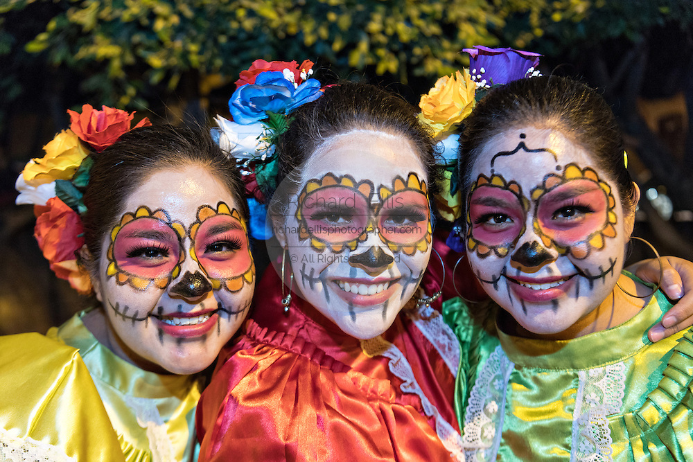 Young women dressed as skeleton maidens during the Day of the Dead festival in the Plaza Civica October 28, 2016 in San Miguel de Allende, Guanajuato, Mexico. The week-long celebration is a time when Mexicans welcome the dead back to earth for a visit and celebrate life.