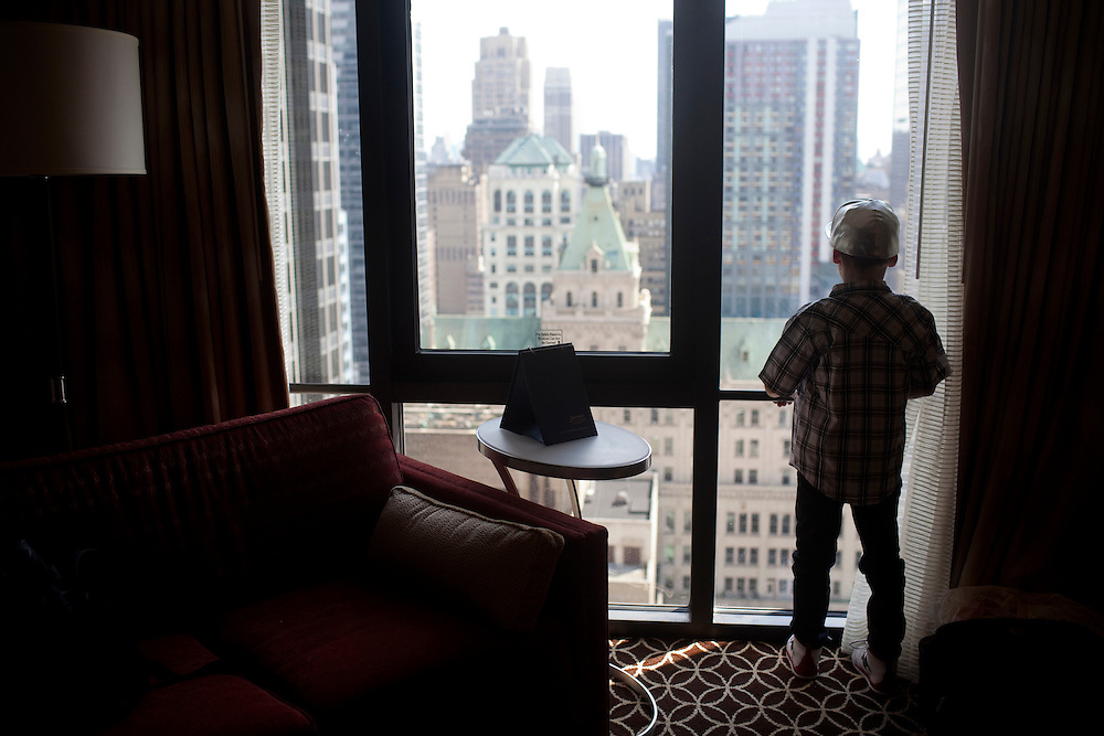 New York, NY - July 05, 2013 : Luke Spring, 10, looks down on Times Square from their hotel room during the New York City Dance Alliance National Summer Workshop held at the Sheraton New York Times Square Hotel in New York, NY on  July 05, 2013. Luke Spring, a dance prodigy from Studio Bleu Dance Center in Ashburn, VA, has performed on the Tonys, Ellen, So You Think You Can Dance and The Ford Gala. His sisters Cami Spring, 20, and Lucy Spring, 18, are both award winning dancers. (Photo by Melanie Burford/Prime for The Washington Post)