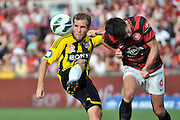 10.03.2013 Sydney, Australia. Wellingtons forward JJeremy Brockie and Wanderers defender and captain Michael Beauchamp in action during the Hyundai A League game between Western Sydney Wanderers and Wellington Phoenix FC from the Parramatta Stadium. The Wanderers won 2-1.