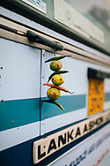 Chilis and limes hang from the back of a bus, Kandy, Sri Lanka, Asia