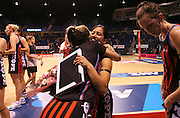 Keshia Grant of the Tactix is congratulated by Gemma Hazeldine following a presentation for 50 games following the ANZ Championship Netball game between the Tactix v Steel at Horncastle Arena in Christchurch. 6th April 2015 Photo: Joseph Johnson/www.photosport.co.nz