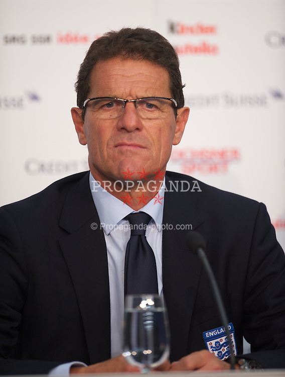 BASEL, SWITZERLAND - Tuesday, September 7, 2010: England's head coach Fabio Capello during a press conference following the the UEFA Euro 2012 Qualifying Group G match against Switzerland at St. Jakob-Park. (Pic by David Rawcliffe/Propaganda)