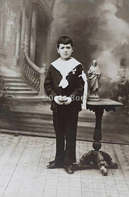 boy posing commemorate his holy communion