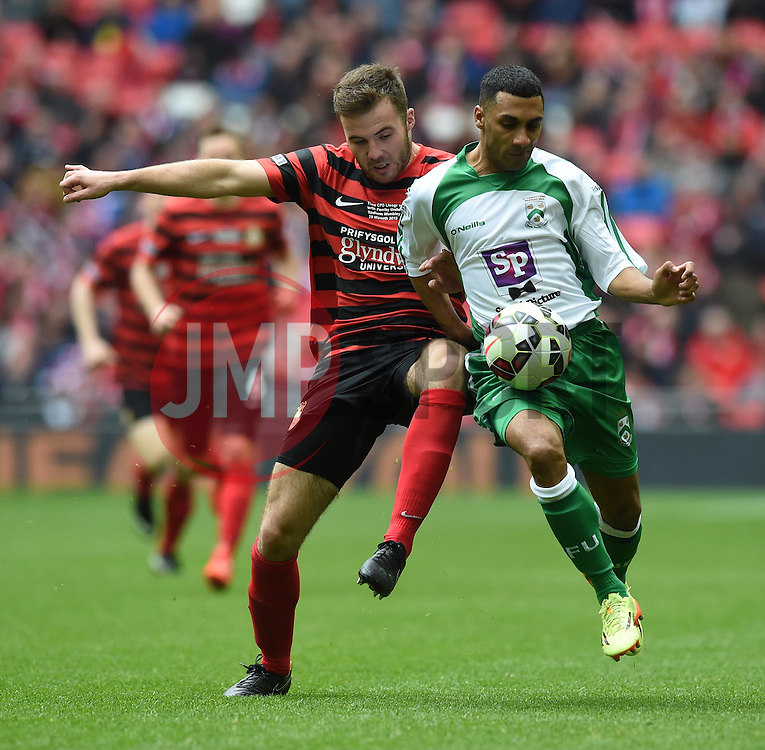 Wrexham's Steve Tomassen challenges North Ferriby's Jason St Juste - Photo mandatory by-line: Paul Knight/JMP - Mobile: 07966 386802 - 29/03/2015 - SPORT - Football - London - Wembley Stadium - North Ferriby United v Wrexham - FA Trophy