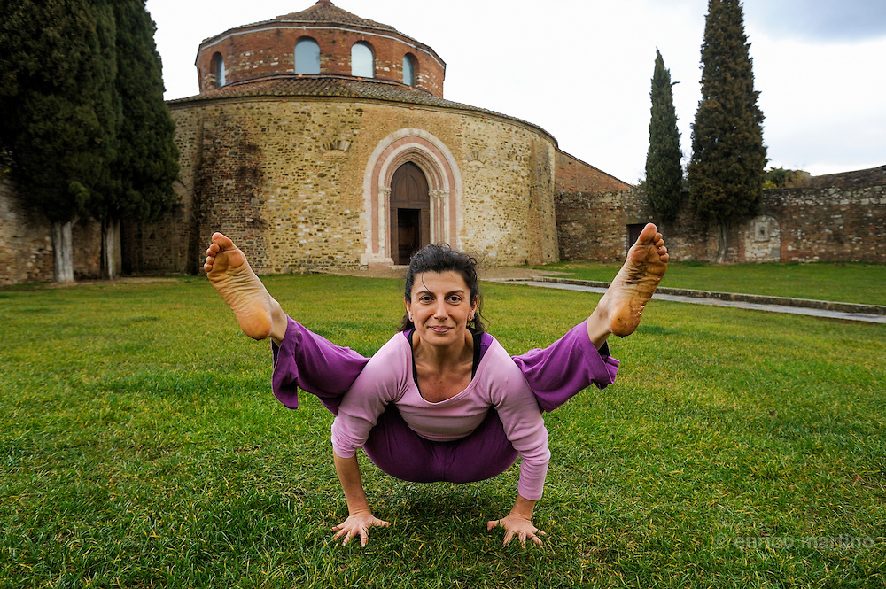Perugia. Carla Ricci, yoga teacher, near St Angelo church that, with his circular architecture, reminds a buddhist stupa.