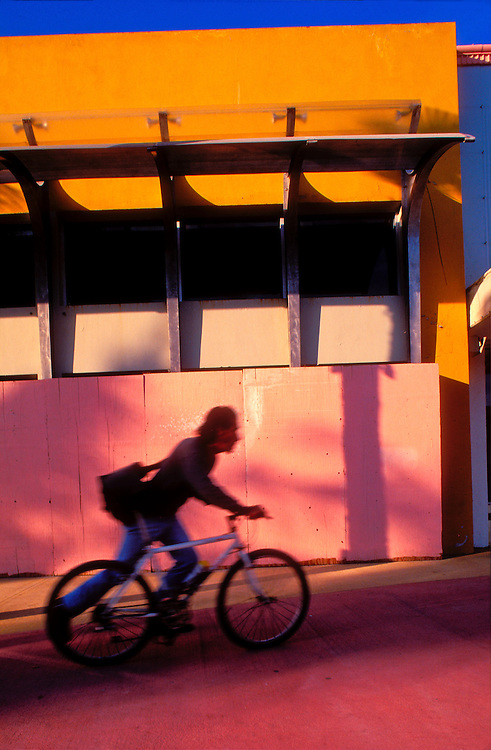 A bicyclist silhouttted against a Post-Modern building on Lincoln Road, Miami Beach's main shopping street.<br />