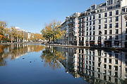 Canal Saint-Martin, with the Quai de Valmy on the left and the apartment blocks of the Quai de Jemappes on the right, in the 10th arrondissement of Paris, France. The Canal Saint-Martin is a 4.6km long waterway between the Canal de l'Ourcq and river Seine, built 1802-25 to provide a fresh water source to the city and provide a trade route for canal barges. Picture by Manuel Cohen