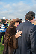 JOAN COLLINS; PERCY GIBSON, Hennessy Gold Cup, The Racecourse Newbury. 30 November 2013.