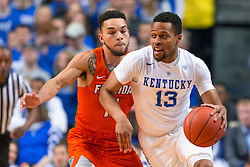 Kentucky guard Isaiah Briscoe, right, drives the ball up the floor with pressure from Florida guard Chris Chiozza in the first half.<br /> <br /> The University of Kentucky hosted the University of Florida, Saturday, Feb. 06, 2016 at Rupp Arena in Lexington .