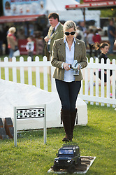 © London News Pictures. 15/05/2014. Sophie, Countess of Wessex playing with her son James (not pictured) on remote control Land Rovers on day two of the Royal Windsor Horse Show. Sophie, Countess of Wessex and her son also enjoyed a test ride in a full size Land Rover together.. Photo credit: Ben Cawthra/LNP