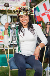 © Licensed to London News Pictures. 11/10/2015. Southwick, UK. Picture shows Amy Fero the new Ladies conker world champion. The 2015 Conker World Championships celebrates it's 50th year with competitors from around the world competing to become this years conker king. Photo credit: Andrew McCaren/LNP