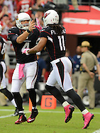 Oct. 14, 2012; Glendale, AZ, USA; Arizona Cardinals wide receiver Larry Fitzgerald (11) is congratulated by quarterback Kevin Kolb (4) after scoring a touchdown against the Buffalo Bills in the first half at University of Phoenix Stadium. Mandatory Credit: Jennifer Stewart-US PRESSWIRE..