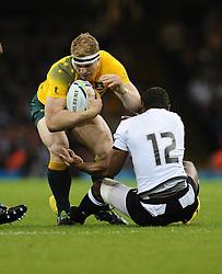 Australia Number 8 David Pocock barges through Fiji Inside Centre Gabiriele Lovobalavu  - Mandatory byline: Joe Meredith/JMP - 07966386802 - 23/09/2015 - Rugby Union, World Cup - Millenium Stadium -Cardiff,Wales - Australia v Fiji - Rugby World Cup 2015 - Pool A
