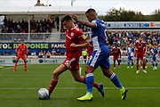 Bristol Rovers forward Jonson Clarke-Harris is tackled by Accrington Stanley defender Ross Sykes during the EFL Sky Bet League 1 match between Bristol Rovers and Accrington Stanley at the Memorial Stadium, Bristol, England on 7 September 2019.