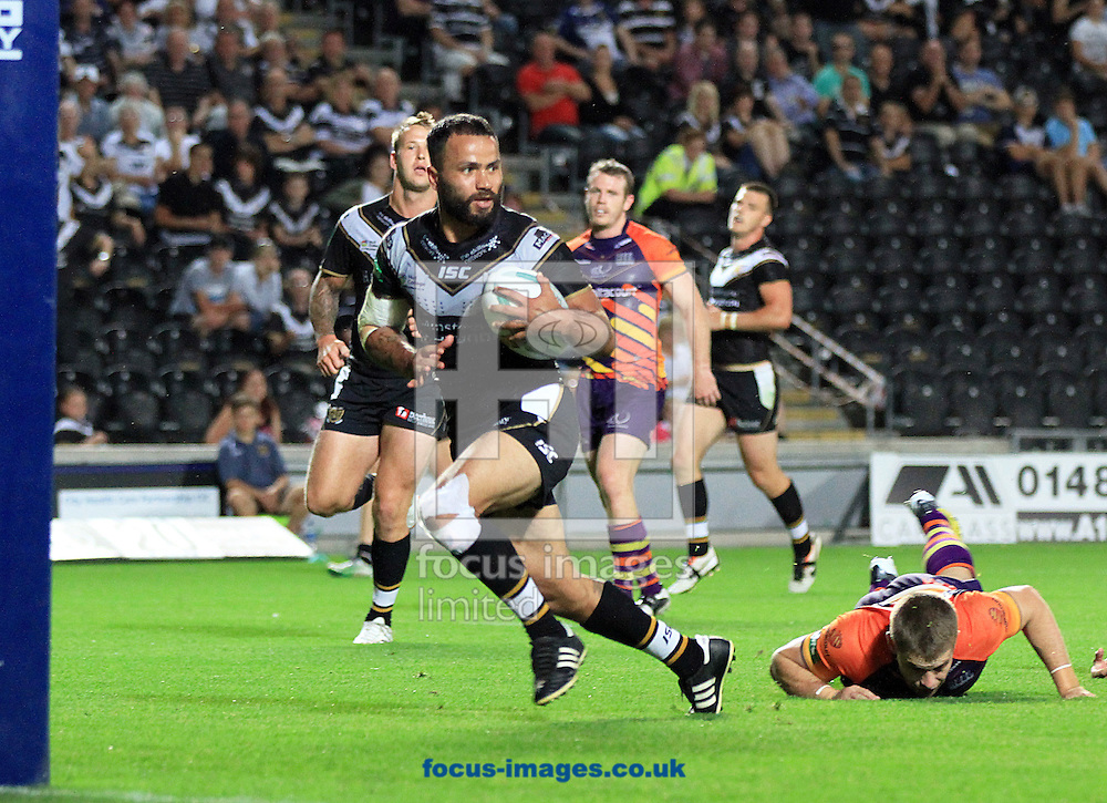 Picture by Richard Gould/Focus Images Ltd +44 7855 403186<br /> 02/08/2013<br /> Aaron Heremaia of Hull Football Club runs in his teams 10th try of the game during the Super League match at the KC Stadium, Kingston upon Hull.