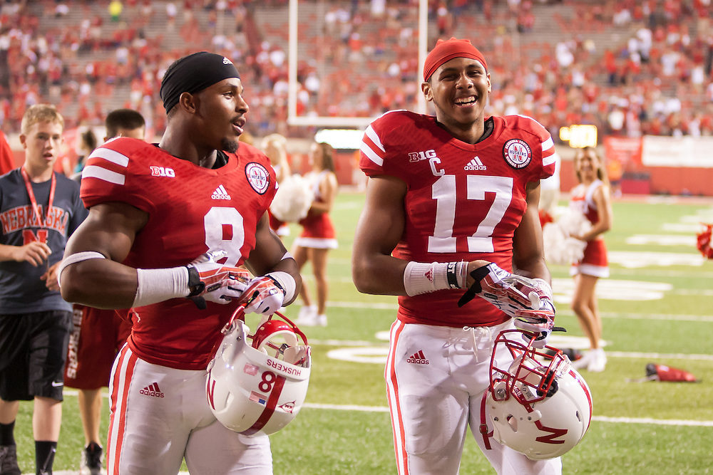 September 7, 2013: Ameer Abdullah #8 and Ciante Evans #17 of the Nebraska Cornhuskers walking off the field after the game against the Southern Miss Golden Eagles at Memorial Stadium in Lincoln, Nebraska.