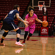 10 February 2018: The San Diego State Aztecs women's basketball team hosts Nevada on Play4Kay day at Viejas Arena. San Diego State Aztecs guard Geena Gomez (20) drives the ball into the key while being defended by Nevada Wolf Pack guard T Moe (13) in the first half. <br /> More game action at www.sdsuaztecphotos.com