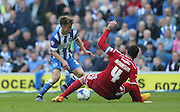 Brighton striker, Solomon March takes on Cardiff City defender Sean Morrison during the Sky Bet Championship match between Brighton and Hove Albion and Cardiff City at the American Express Community Stadium, Brighton and Hove, England on 3 October 2015.