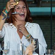 NLD/Amsterdam/20130916 -  Modeshow Jos Raak in het Conservatorium hotel, Leontien Borsato heft het glas