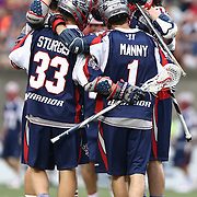 Members of the Boston Cannons celebrate a goal during the game at Harvard Stadium on July 19, 2014 in Boston, Massachusetts. (Photo by Elan Kawesch)