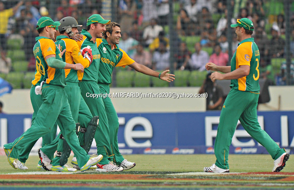 Imran Tahir celebrates the wicket of Ross Taylor during the ICC Cricket World Cup quarter final match between South Africa and New Zealand held at the Shere Bangla National Stadium, Mirpur, Bangladesh on the 25 March 2011..Photo by SPORTZPICS