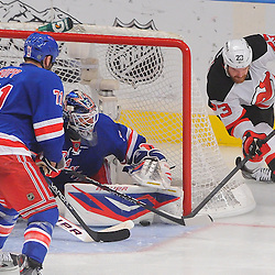 May 16, 2012: New York Rangers goalie Henrik Lundqvist (30) makes a save on New Jersey Devils right wing David Clarkson's (23) wraparound shot during third period action in game 2 of the NHL Eastern Conference Finals between the New Jersey Devils and New York Rangers at Madison Square Garden in New York, N.Y. The Devils defeated the Rangers 3-2.