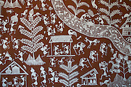 A primitive style wall painting on the side of a house at Shilpgram Craftsmen's Village, Udaipur, Rajasthan, India