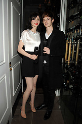 Singer SOPHIE ELLIS-BEXTOR and RICHARD JONES at a party to launch the Dom Perignon OEotheque 1995 held at The Landau, Portland Place, London W1 on 26th February 2008.<br />