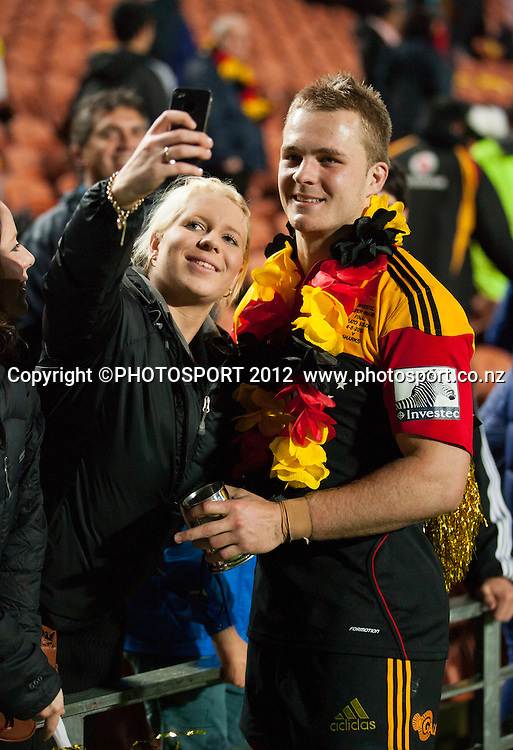 Chiefs' Sam Cane has a picture with a fan after the Investec Super Rugby final between Chiefs and Sharks won by Chiefs 37-6 at Waikato Stadium, Hamilton, New Zealand, Saturday 4 August 2012. Photo: Stephen Barker/Photosport.co.nz