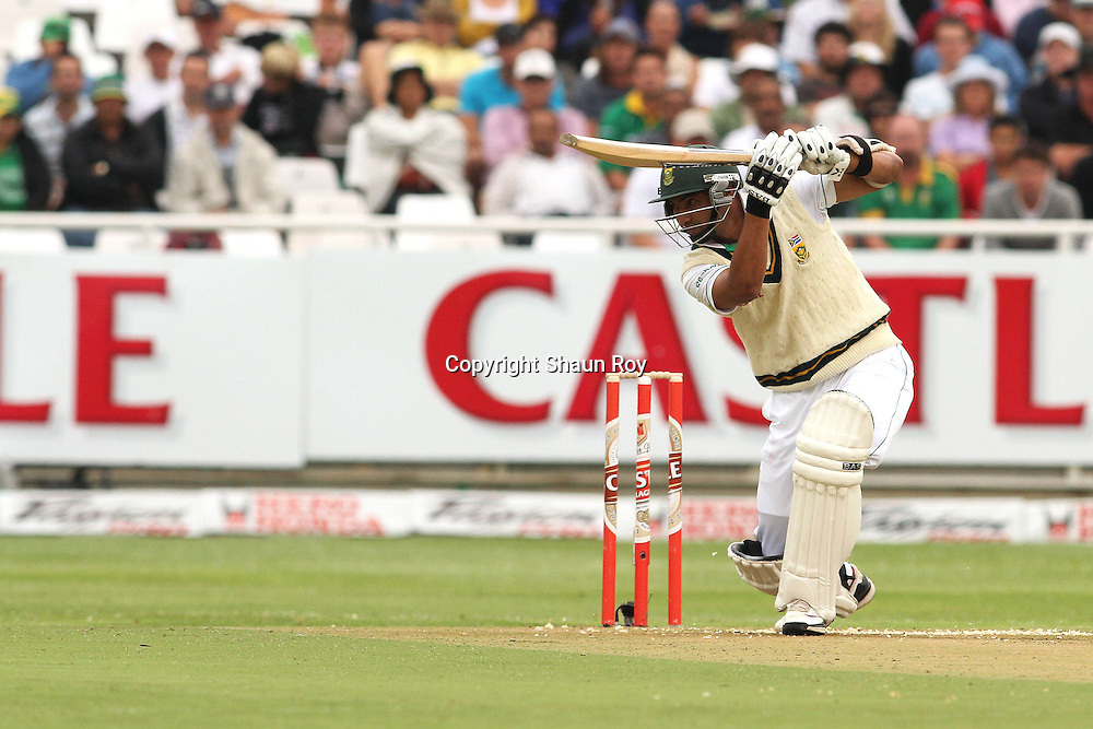 CAPE TOWN, SOUTH AFRICA - 2 January 2011, Alviro Petersen of South Africa drives a delivery into the covers during day 1 of the 3rd Castle Test between South Africa and India held at Sahara Park Newlands Stadium in Cape Town, South Africa on the 2 January 2011 .Photo by: Shaun Roy