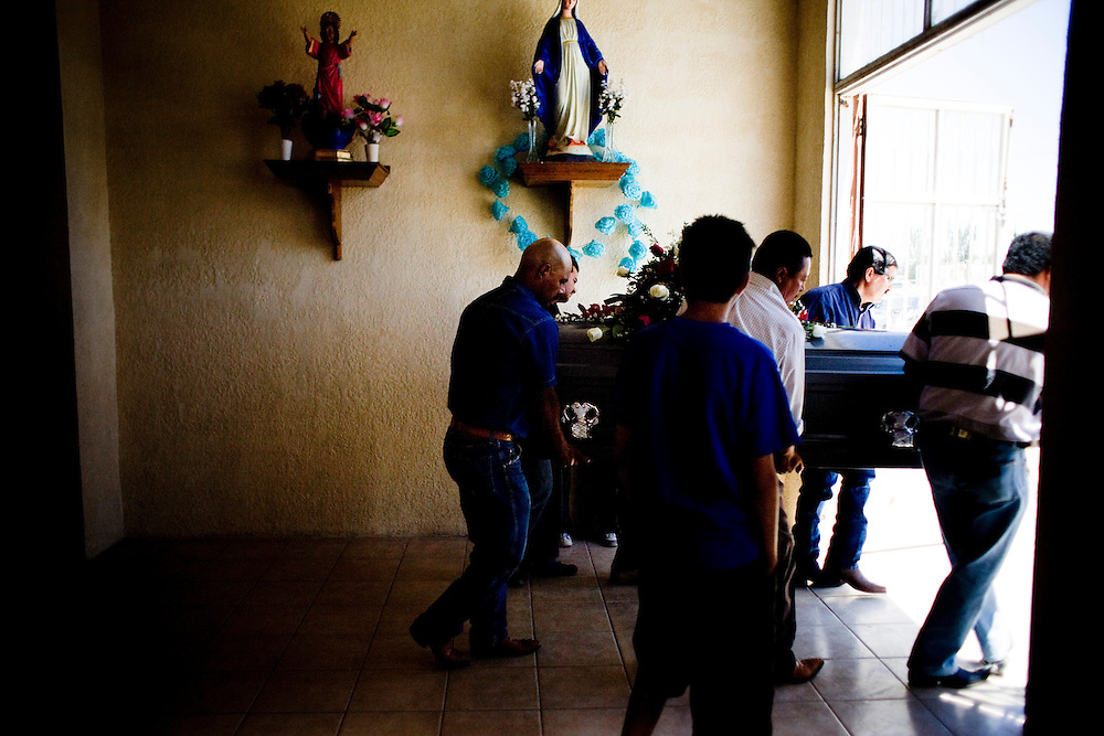 Family members and friends carryout the casket of a Municipal Police officer in Ciudad Juarez, Chihuahua on May 21, 2010.
