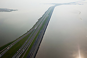 Nederland, Friesland, Gemeente Wonseradeel, 28-04-2010; begin van de Afsluitdijk vanuit Friesland, met Kornwerderzand, gezien naar het westen (naar Noord-Holland). .Aanleg van de dijk vormde onderdeel Zuiderzeewerken, initiatief van ingenieur Cornelis Lely..Enclosure Dam from the coast of Friesland, with Kornwerderzand, seen west (to North-Holland). Construction of the dam was part of the Zuiderzee Works, an initiative of engineer Cornelis Lely..luchtfoto (toeslag), aerial photo (additional fee required).foto/photo Siebe Swart