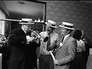 "Guinness Jazz Festival, Cork.01/07/1982.Topping the bill at the festival were,The First Lady of Jazz, ""Ella Fitzgerald"",The legendary ""B.B.King"" and the unique ""Modern Jazz Quartet""..At the reception Mr Bobby Howick, Trade Director Guinness Group Sales, tries out the trumpet of Mr Pieter Sluis (centre)..Mr Sluis is a member of The Bruxelles Jazz Group,who played at the reception. Also pictured is Mr Jim Mountjoy, Metropole Hotel, Cork. Mr Mountjoy is a Co-festival Director."